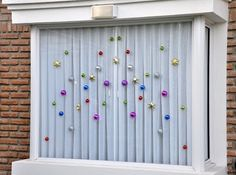 Interesting Way this blogger hug this window decoration without any damage or markings.