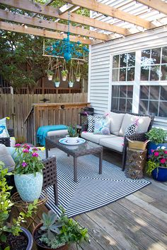 We love this flower-filled outdoor living room styled by Stephanie Fisher of Glitter and Goat Cheese. It's her update of a previous Patio Style Challenge, adding even more color and charm. See more of her eclectic and colorful back deck on The Home Depot Blog. || @stephsfisher