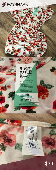 NWT Honey & Lace Piphany Floral Oakland Tunic L Brand new with tags floral Oakland tee. Excellent condition, gorgeous white background with red and orange flowers. Just downsizing my clothing collection before spring! Honey and Lace Tops Tunics