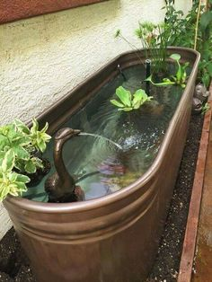 stock tank is given a makeover with metallic copper color paint and transformed into a beautiful fountain!A stock tank is given a makeover with metallic copper color paint and transformed into a beautiful fountain! Landscape Design, Garden Design, Desert Landscape, Abstract Landscape, House Design, Container Pond, Container Water Gardens, Ponds Backyard, Garden Ponds