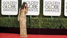 """She's killing it! Piyanka Chopra attended her first Golden Globe Awards (2017) Sunday, making a splash on the red carpet.  Styled by Cristina Ehrlich, the Quantico actress stunned in a glided Ralph Lauren gown with a plunging v-neckline."""" Awesome hair, makeup and styling. She looks great: like a star should."""