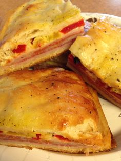 Antipasto Squares = Yummy! Crescent rolls on top and bottom, filled (layered) with ham, salami, pepperoni, swiss, & provolone cheese. Topped with (3 eggs beaten & crushed blk pepper). Baked at 350 for 25 minutes.... Yummy again