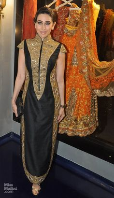 Mayyur Girotra black and gold collared suit. Id actually have a slit down the middle and make the hem even. the bottom would be slick gold embroidered salwar pants