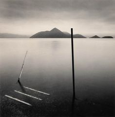 Michael Kenna (born 1953) is an English photographer best known for his black & white landscapes.  Kenna attended Upholland College in Lancashire, the Ban
