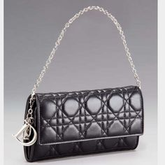 Dior Lady Dior Cannage Renezvous chain wallet Gorgeous 100% authentic Dior chain wallet. Gently used and shows some wear (see photo # 4) but still in great condition!! And priced accordingly. Lambskin leather and Dior classic quilted pattern. Can be used as a wallet or a wristlet/clutch. Super cute! Dior Bags Wallets