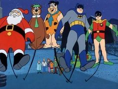 Santa, Yogi, Fred Flintstone, Batman, and Robin balloons