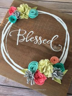 The fun colors in this Blessed sign are great to freshen up your decor. Crafted on reclaimed barn board, its sure to complement any decor. If youd prefer flowers in a different color, please be sure to let us know upon checkout. Because our signs are cre Decor Crafts, Wood Crafts, Diy Crafts, Felt Flowers, Fabric Flowers, Blessed Sign, Rustic Wall Decor, Farmhouse Decor, Craft Night