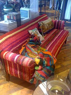 A crocheted sofa cover. Cool!