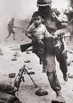 Vietnam War look an american saveing two babys in a fire fight looks like the NAV didn't give a shit about those kid's. Thanks Hollywood for perpetuating the denomination of american hero for 40 years.