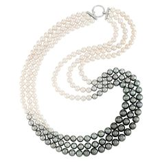 Triple Strand Tahitian and Cultured Pearl Ombré Necklace with White Gold and Diamond Clasp 18 kt., 230 black to white pearls ap. 11.9 to 8.0 mm., round diamonds. Length 29 inches.