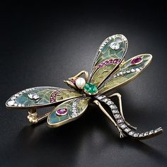 Art Nouveau dragonfly brooch, circa 1900.  Red rubies, old-mine and rose cut diamonds, pearl and cobochon emerald.