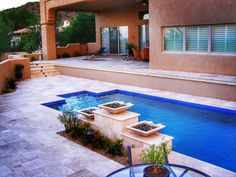 How about a water feature with 3 spill way pots an elevated spa and a very cool waterline tile to work with all that travertine #outdoorliving #luxurylifestyle #luxury #spa #houzz #pool #swimming #swimmingpool #scottsdale #design #waterfeature #travertine #lighting