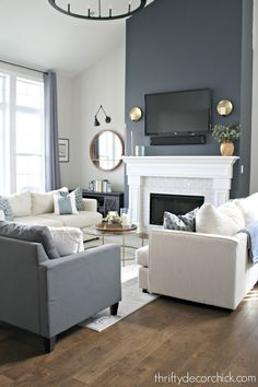fireplace transformation with paint! Fireplace wall color is Cyberspace from Sherwin-Williams. It's an absolutely PERFECT dark gray/blue. Sometimes it looks navy, sometimes it's more dark gray.Fireplace wall color is Cyberspace from Sherwin-Williams. Navy Living Rooms, Accent Walls In Living Room, New Living Room, Living Room Furniture, Funky Furniture, Furniture Design, Antique Furniture, White Fireplace, Living Room With Fireplace