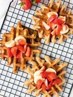 This is a delicious homemade waffle recipe. Top these whole wheat buttermilk waffles with maple syrup and fresh fruit for a family friendly breakfast. Enjoy our family's recipe for the best ever buttermilk waffles! Easy to make, crispy on the outside, and chewy on the inside. Recipe from www.theworktop.com.    #waffles #breakfast #brunch Breakfast For A Crowd, Breakfast Waffles, Sweet Breakfast, Breakfast Ideas, Pancakes, Breakfast Time, Waffle Recipes, Brunch Recipes, Sweet Recipes