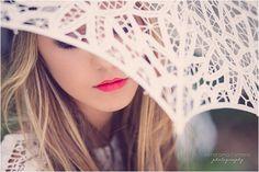 creative photo with beautiful lace umbrella and red lips, pretty girl, boho girl, fashion photography by Estefania Romero