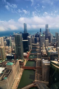 Aerial photo of Chicago featuring Chicago River, Trump Tower, Merchandise Mart and Lake Michigan.