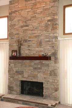 Stone For Fireplaces two-story modern farmhouse foyer with stone fireplace and catwalk