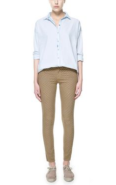 TROUSERS WITH POCKETS AND POLKA DOTS