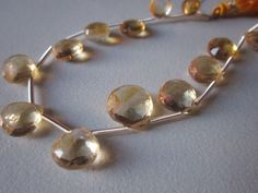 Citrine faceted almond beads loose 7 piece 8mm-12mm