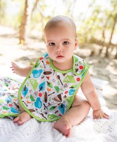 Oversized Designer Bibs in your favorite Nuggles print! Wipe-down water-resistant polyester front with plush minky backing. 3 adjustable neck settings to fit 0-3+ years. So cute! 100% polyester - machine wash & dry.