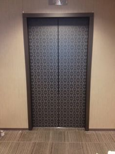 Custom design created to resurface old elevator doors imaged by Brassell Design Consultants