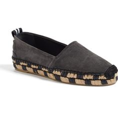 A checkerboard-woven espadrille platform lifts this classic slip-on crafted from luxurious Italian lambskin suede.