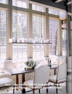 Love Dining Room Dining Table Chairs, Candle light fixture Floor to ceiling windows #interior #design #inspiration   architecture by Ruard Veltman, interiors by Ann Dupuy