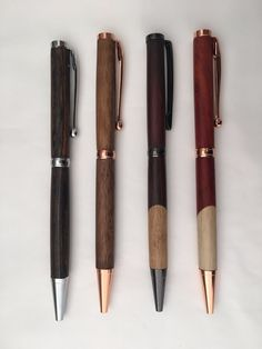 Hand turned wood pen. The easy to use twist mechanism pulls apart at the center band so you can change out the cross style refills for blue, black, and red ink. If buying online please specify wood -                                                                                                                                                                                  More