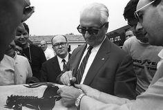 Enzo Ferrari signing autographs.. 1966 Italian Grand Prix, Autodromo Nazionale Monza