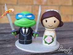 teenage mutant ninja turtle wedding cake top except the turtle would have to be Michelangelo for sure