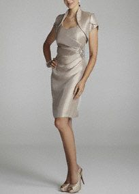 Elegant is an understatement, words cannot describe how amazing you will look in this stunning shimmer jacket dress!  Sleeveless bodice features sensational stretch shimmer fabric sure to flatter any figure.  Side ruching features sparkling beaded detail.  Short sleeve jacket provides just the right amount of coverage.  Fully lined. Back zip. Imported poly/rayon/spandex blend. Dry clean.