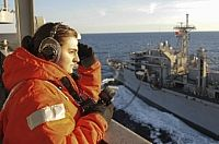 Seaman Haley King, from Springfield, Ohio, stands the starboard watch aboard the Nimitz-class aircraft carrier USS George H.W. Bush (CVN 77) during a replenishment-at-sea with the Military Sealift Command combat support ship USNS Arctic (T-AOE 8).