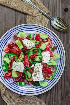 Traditional Greek salad as served on the Greek islands & villages. A few quality vegetables like tomatoes & cucumbers. Olive oil, olives & creamy feta!