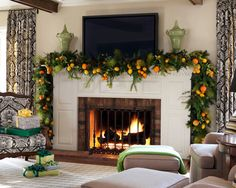 Fresh fruits and a green garland express a classic viewpoint of Christmas.  Della Robia wreaths