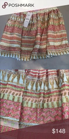 Parker beaded skirt Parker beaded shirt. NWT. Polyester with detailed multicolored stitching and gold beading. Can be dressed up or down. Runs a little small unless worn on actual waist. Parker Skirts Mini