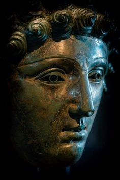 Roman parade mask. ~ this would have been on a helmet like a visor. The theory was that these Roman 'parade' masks weren't used in war but a mask on a helmet was found on the Teutonburg Forest/Varus Disaster battlefield.