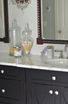 living with marble countertops. Like the knobs on this vanity.