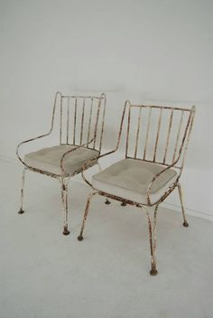 pair of early 20th wrought iron armchairs