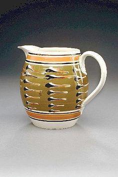 RARE BRITISH CREAMWARE MOCHAWARE JUG, CIRCA 1830.