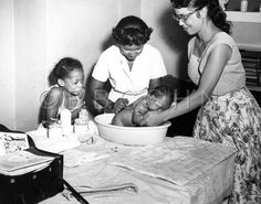 Nurse bathes an infant with the help of the mother, Visiting Nurse Society of Philadelphia, c. 1957. Image courtesy of the Barbara Bates Center for the Study of the History of Nursing.