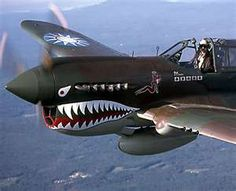 P-40 Warhawk (United States Army Air Corps) Tomahawk and Kittyhawk (for The British Commonwealth and Soviet air forces).  Also flown by the Flying Tigers in China.