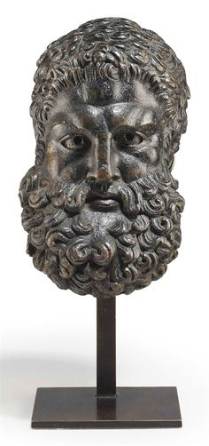 A ROMAN BRONZE HEAD OF HERCULES, CIRCA 1ST CENTURY A.D. 4 3/8 in. (11.1 cm.) high. I Christie's