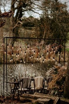 Winter wedding outdoor lighting at this intimate Sussex wedding at Frickley Lake. Winter wedding outdoor lighting at this intimate Sussex wedding at Frickley Lake. Winter wedding outdoor lighting at t. Rustic Wedding Signs, Woodland Wedding, Outdoor Chandelier, Outdoor Lighting, Fall Wedding, Wedding Table, Witch Wedding, Wedding Ideas, Hippy Chic