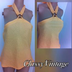 Ready for summer yellow halter top. Show off your tan in this summer yellow halter top. Elastic at back and ties at neck. Wood ring detail in front. J.M.P. Tops