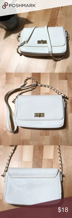 Forever 21 Crossbody Bag This cute crossbody from Forever 21 is a knockout! Features a faux leather design with gold hardware and a strap with a chain accent. Some wear but still good condition. Sold as is. Forever 21 Bags Crossbody Bags