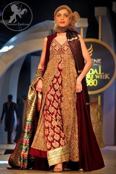 Maroon heavy formal pishwas is beautiful but could do without the cloth suffocating her.