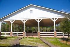 Barn Pavillion. but have garage doors on the open parts so you can open them on hot days and close them with its raining or whatever.