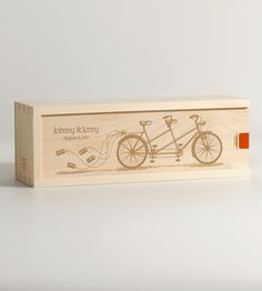 Celebrate the beginning of a romantic journey with this wood wine box, engraved with the image of a tandem bike and trailing clanging cans. Personalize your gift with the names of the happy couple and the wedding or anniversary date. All that's left for you to do is nest a bottle of their favorite vino inside and seal it with the included embossed label.