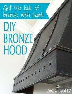 Want the look of bronze at a fraction of the cost? Using Metal Effects and tacks from Hobby Lobby you can create the look of a high-end bronze range. This DIY Bronze Range Hood  will save you thousands and make a statement!