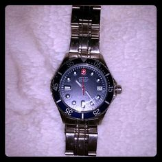 Wenger Swiss Military watch Great condition.  Navy blue coloring around clock.  Works great! Bought for brand new. My dad never wore it. Wenger  Jewelry